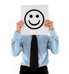 The photo shows a jobseeker smiling because he has found the careers advice helpful in his search for a new job